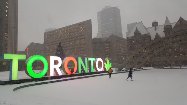 Snow falls at Nathan Phillips Square on Jan. 10, 2017. (Sandie Benitah/ CP24)